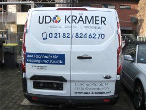 Autobeschriftung mit Folienschrift und Digitaldruck eines Ford Transit Custom der Firma Udo Krämer für in Grevenbroich Kapellen.