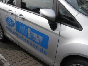 Fahrzeugbeschriftung (Autobeschriftung) eines Ford B-Max für den Ford-Händler Auto-Breuer aus Grevenbroich Wevelinghoven.
